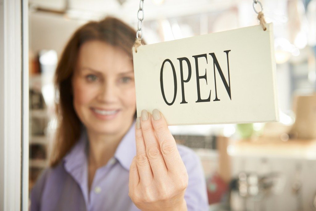 Woman Opening Local Store